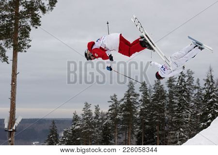 KRASNOE OZERO, LENINGRAD REGION, RUSSIA - FEBRUARY 1, 2018: Ilya Chevskiy (red) of Russia and Oskar Elofsson of Sweden compete in dual mogul during Freestyle Europa Cup competitions. Elofsson won gold