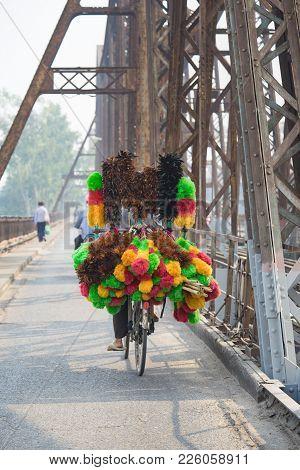 Vendor Bike With Full Loaded Of Feather Duster On Long Bien Old Metal Bridge, Hanoi
