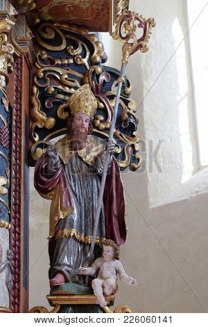 VUKOVOJ, CROATIA - OCTOBER 08: St. Augustine of Hippo statue on the main altar in the chapel of St. Wolfgang in Vukovoj, Croatia on October 08, 2016.