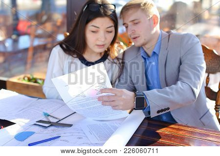 Students Calling Professor By Smartphone To Ask About Architecture Project. Boy And Girl Drawing Wit