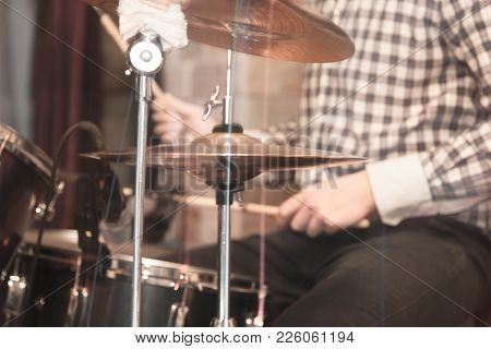 Playing The Drum Set . Photos In The Studio