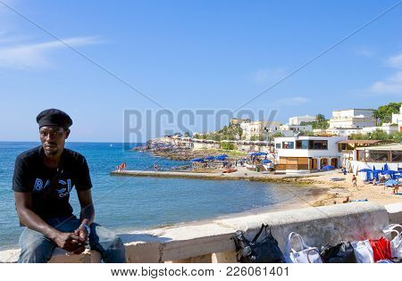 Santa Maria Di Leuca, Italy - August 27, 2006: Young Vendors Caming From The Africa, In The Market O