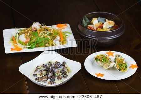 Set Of Asian Seafood With Grilled Geoduck With Onion And Grease, Coconut Escargot, Shrimp Stir-fried