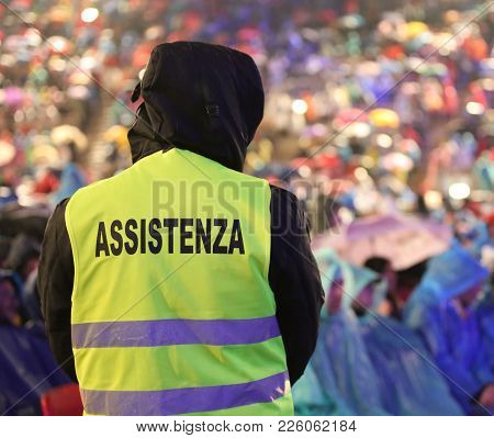 Italian Security Guard During The Important Event With Text Assistenza That Means Assitance In Itali