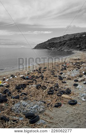 Sea Beach Full Of Pneumatics And Others Litter And Waste