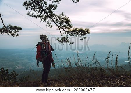 Women Asians Travel Relax In The Holiday. Admire The Atmosphere Landscape On The Moutain. Mountain P