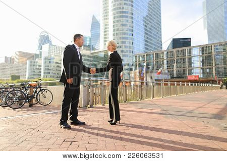 Male Financial Manager Talking With Employees Outdoors. Concept Of Conversation With Boss And Decisi