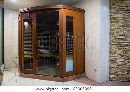 A Small Wooden Infrarered Sauna Booth In A Spa
