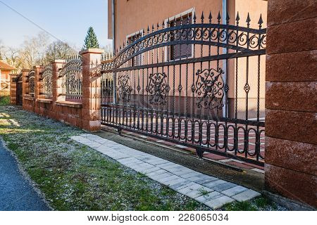 Iron Fence With Iron Gate. Fence With Wall