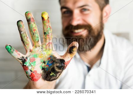 Colorful Man Hand. Bearded Handsome Man Shows Palm With Paints, Smiles In Camera, Happiness Art, Hap