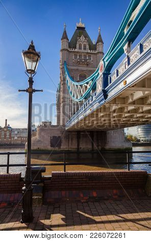 London cityscape with Tower Bridge pictured from the North Bank of the River Thames in 2012 at a sunny autumn day