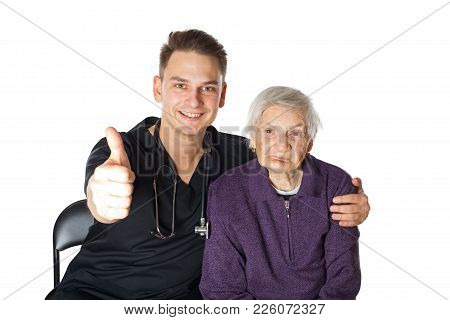 Senior Ill Woman With Friendly Male Carer Showing Thumbs Up On Isolated Background