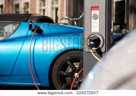 Charging New Blue Electric Car