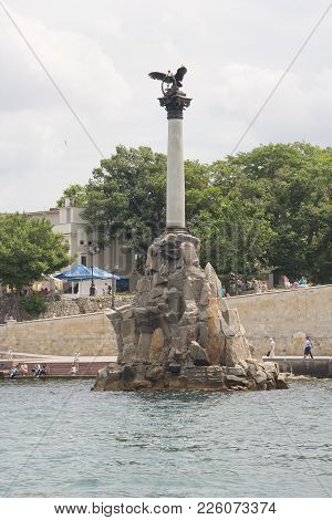 Crimea, Sevastopol, June 13, 2014: View Of The Embankment Of Sevastopol And Monument To The Scuttled