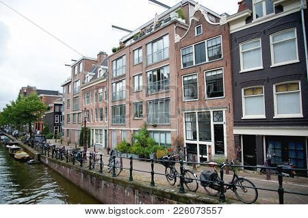 City view of Amsterdam canal and bikes