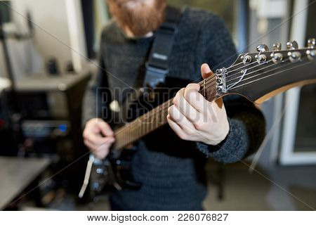 Close-up Of Unrecognizable Hipster Musician Composing New Melody While Playing Electric Guitar And H