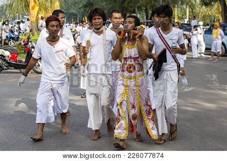 Thai People In Vegetarian Festival At Phuket Town. Thailand. Festival Is A Famous Annual Also Known