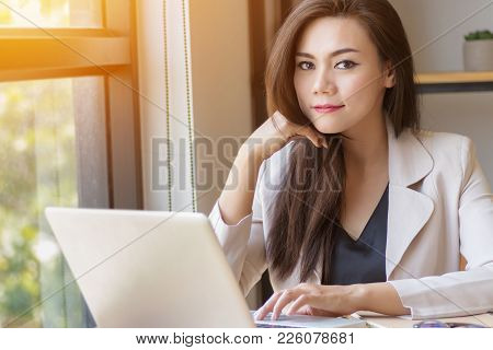 Startup Business In Asia Concept. Focused Young Asian Business Woman With Thinking Face Working With