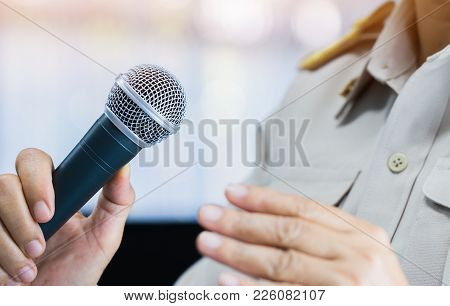 Thai Teacher Speaking In Classroom Or Conference Meeting Hall With Microphone Of Speech In Seminar R