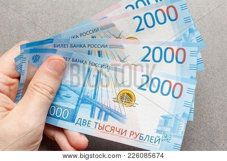 New Russian Banknotes Denominated In 2000 Rubles In The Male Hand Close-up, Top View