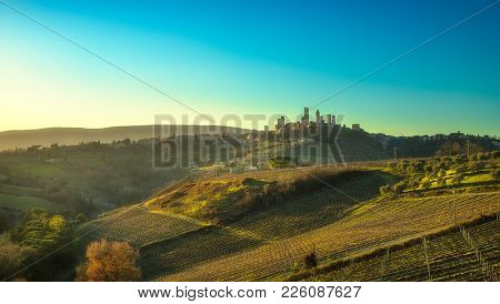 San Gimignano Medieval Town Towers Skyline And Countryside Landscape Panorama On Sunset. Tuscany, It