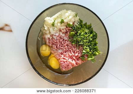 Pork Minced Meat, 2 Eggs, Chopped Onion And Parsley, Herbs, Plate With Ingredients For Cooking Meat