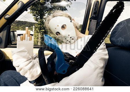 Chainsaw Murderer Is Quite Happy To Get A Ride In Your Car And Offers You Some Cigarettes.