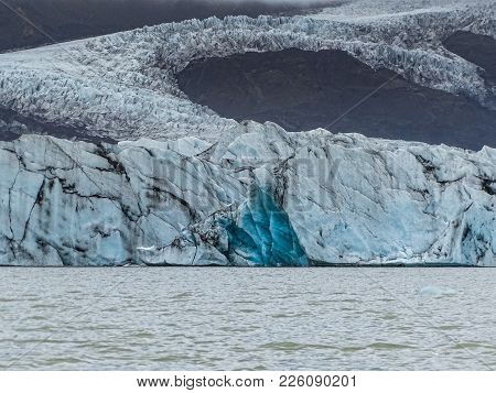 Famous And Beautiful Glacier Lagoon Fjallsarlon In Iceland With Blue Icebergs