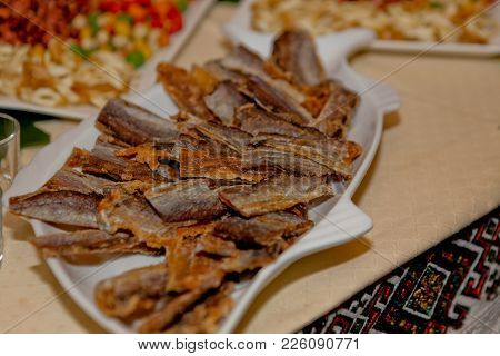 Dried Fish On A Plate, Snack On A Wedding Table.