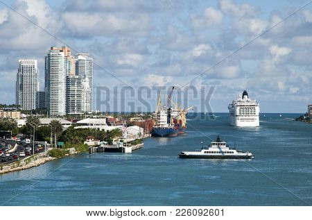 The Busy Water Traffic In Miami Main Channel, The Gateway To Open Sea (florida).