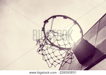 B&w Vintage Wooden Basketball Hoop With Sunset