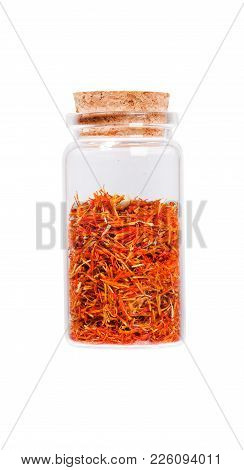 Saffron Stamens In A Glass Bottle With Cork Stopper, Isolated On White.