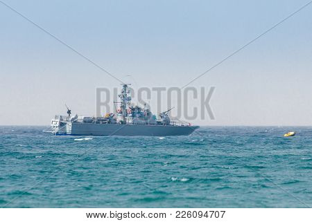All-weather Patrol Boat Patrol On A Cloudy Day Near The Shore Of The Sea Space Of The Country