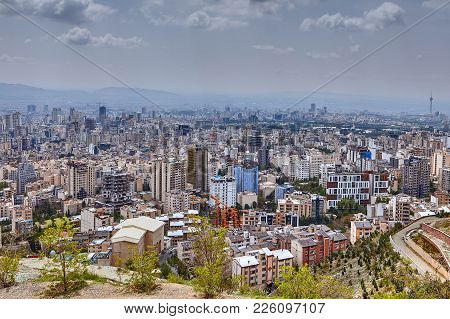 Tehran, Iran - April 28, 2017: Skyline View On Capital City Of Iran With High-rise Buildings, And Pu