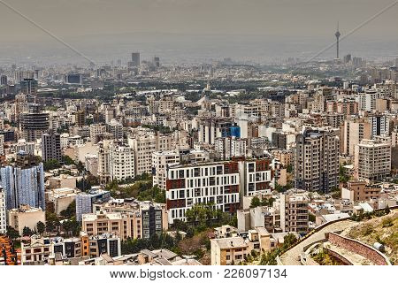 Tehran, Iran - April 28, 2017: City View Of Tehran With Multi-story Houses, And Public Parks.
