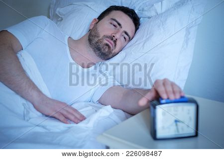 Upset Man Trying To Wake Up From The Bed