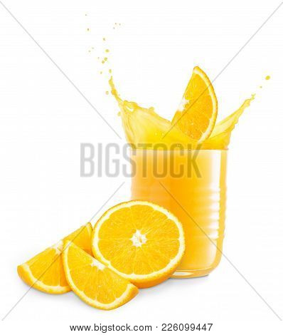 Orange Slice Falling Into Juice Creating Splashes. Isolated On White Background. Glass Of Splashing