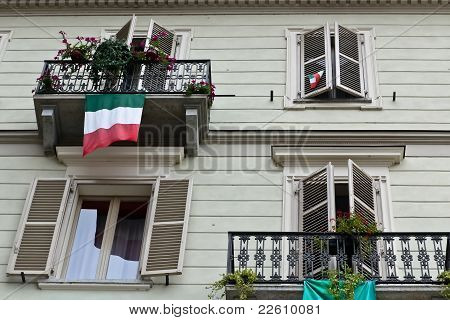 Italian House Facade With Flags