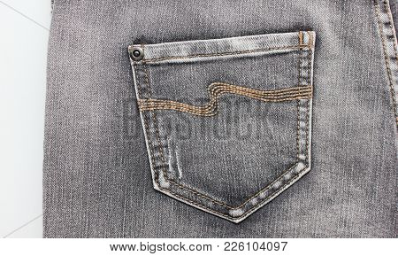 Denim Jeans Back Side View Of Pale Gray Color Jeans With Pockets. Washed Out Vintage Style Denim Pan