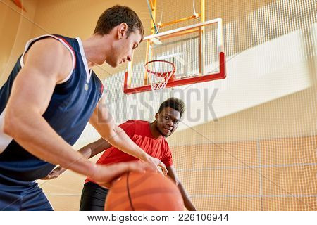 Concentrated Confident Young African-american Man Controlling Basketball Competitor Dribbling Trying