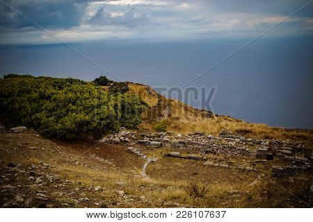 The Ruins Of Ancient Thera At The Top Of The Mountain Mesa Vouno In Santorini Island, Greece