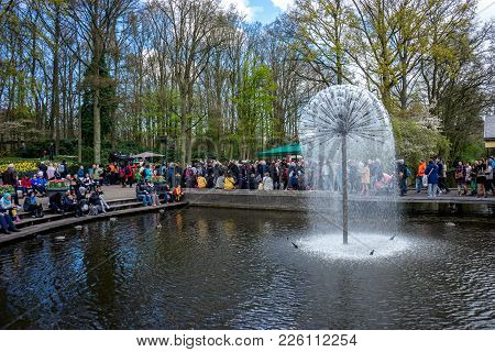 Keukenhoff, Netherlands - April 17 : The Keukenhoff Tulip Gardens On April 17, 2016. Tourists Gather