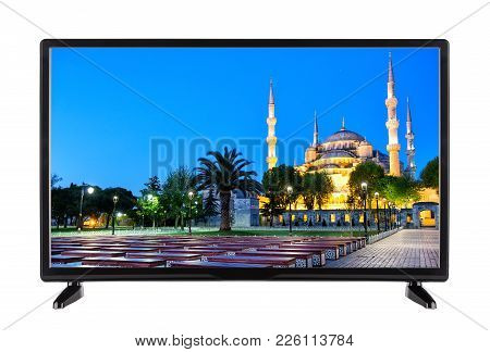 Flat Tv With A Picture Of  Mosque And  Palm Tree On The Screen