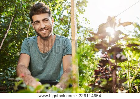 Healthy Lifestyle. Vegetarian Food. Close Up Portrait Of Young Cheerful Bearded Caucasian Man Smilin