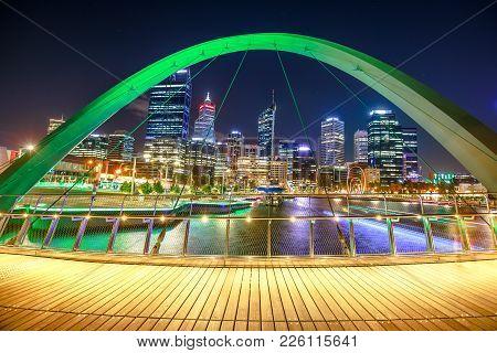 Perth, Australia - Jan 5, 2018: Arcade Of Iconic Elizabeth Quay Pedestrian Bridge Illuminated By Nig