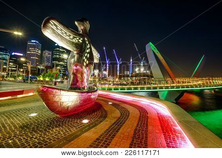 Perth, Australia - Jan 5, 2018: First Contact Sculpture On Foreground At Elizabeth Quay Marina Illum