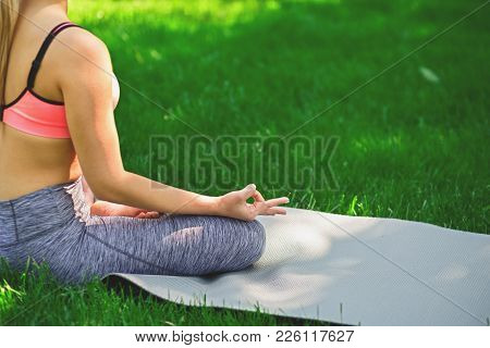 Young Woman Outdoors, Meditation Exercises, Back View, Crop. Girl Does Lotus Pose For Relaxation. We