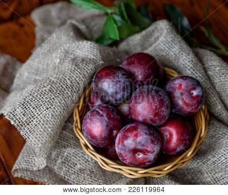 Plum. Fresh Plum. Harvest. Autumn Harvest. Autumn. Blue Plums. Yellow Plum. Fresh Plums On A Wooden