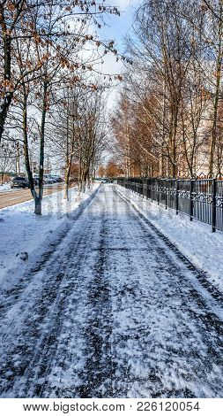 The Cleared Road In The Park, Cleaned In The Winter In The City, The Road Cleaned By A Sunny Day. As