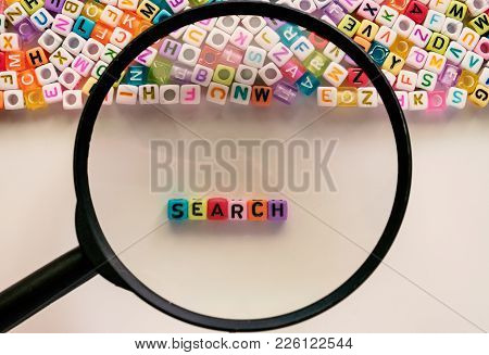 Search Word And Alphabet Letter Beads Enlarged By The Magnifying Glass On White Background For Searc